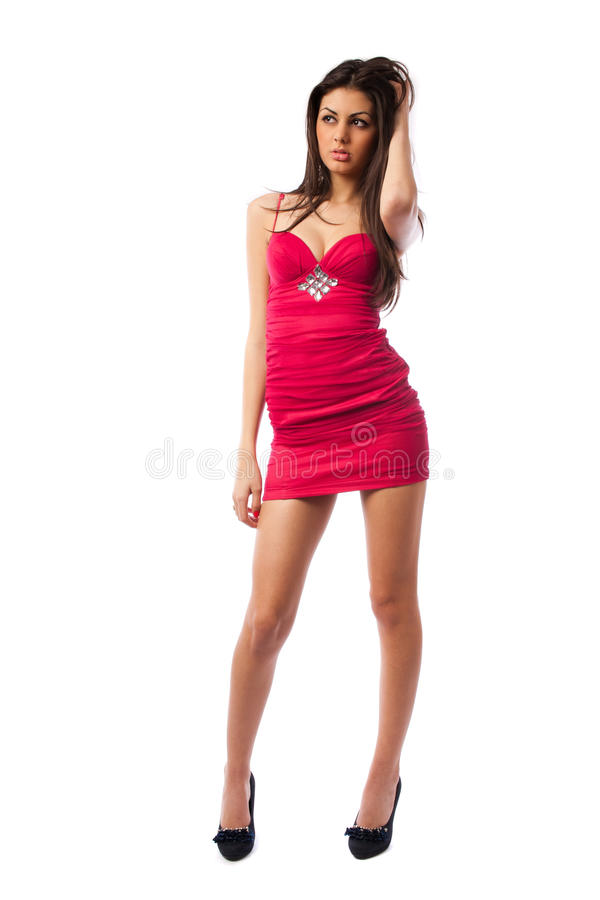Gorgeous lady in red dress, royalty free stock image