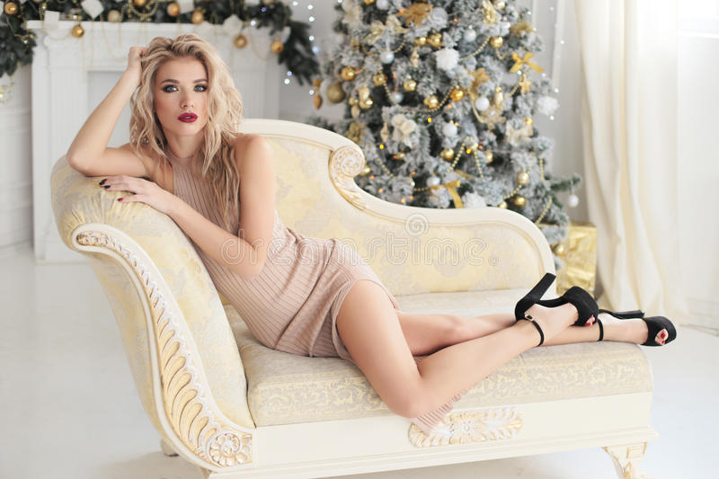 Gorgeous woman with blond hair in beige dress royalty free stock photos