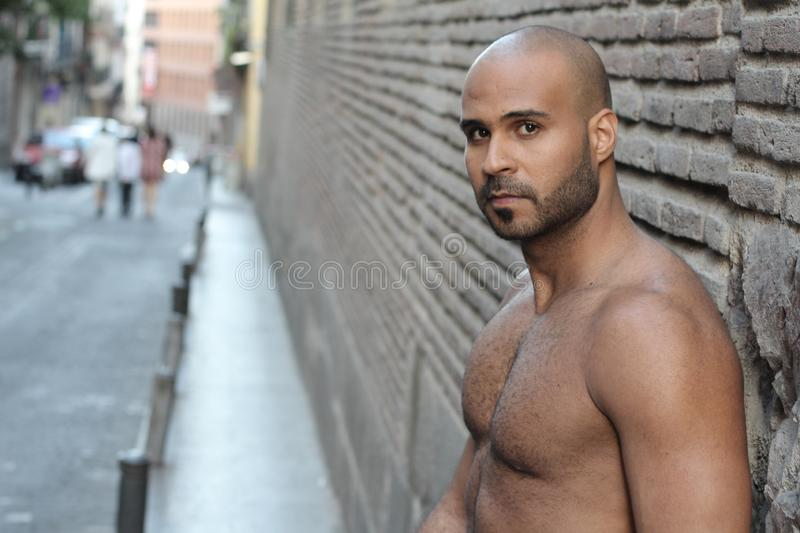 Gorgeous shirtless ethnic man with copy space stock photo