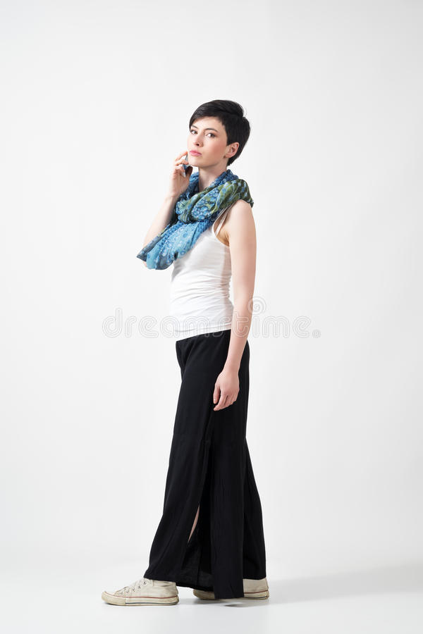 Gorgeous short hair brunette woman talking on the phone looking at camera stock image