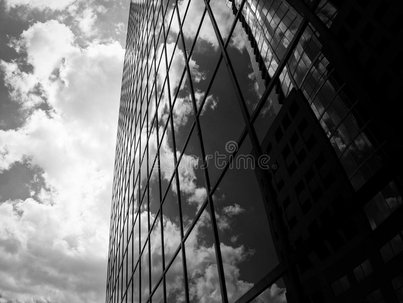 Clouds Reflecting on a Glass Building royalty free stock photography