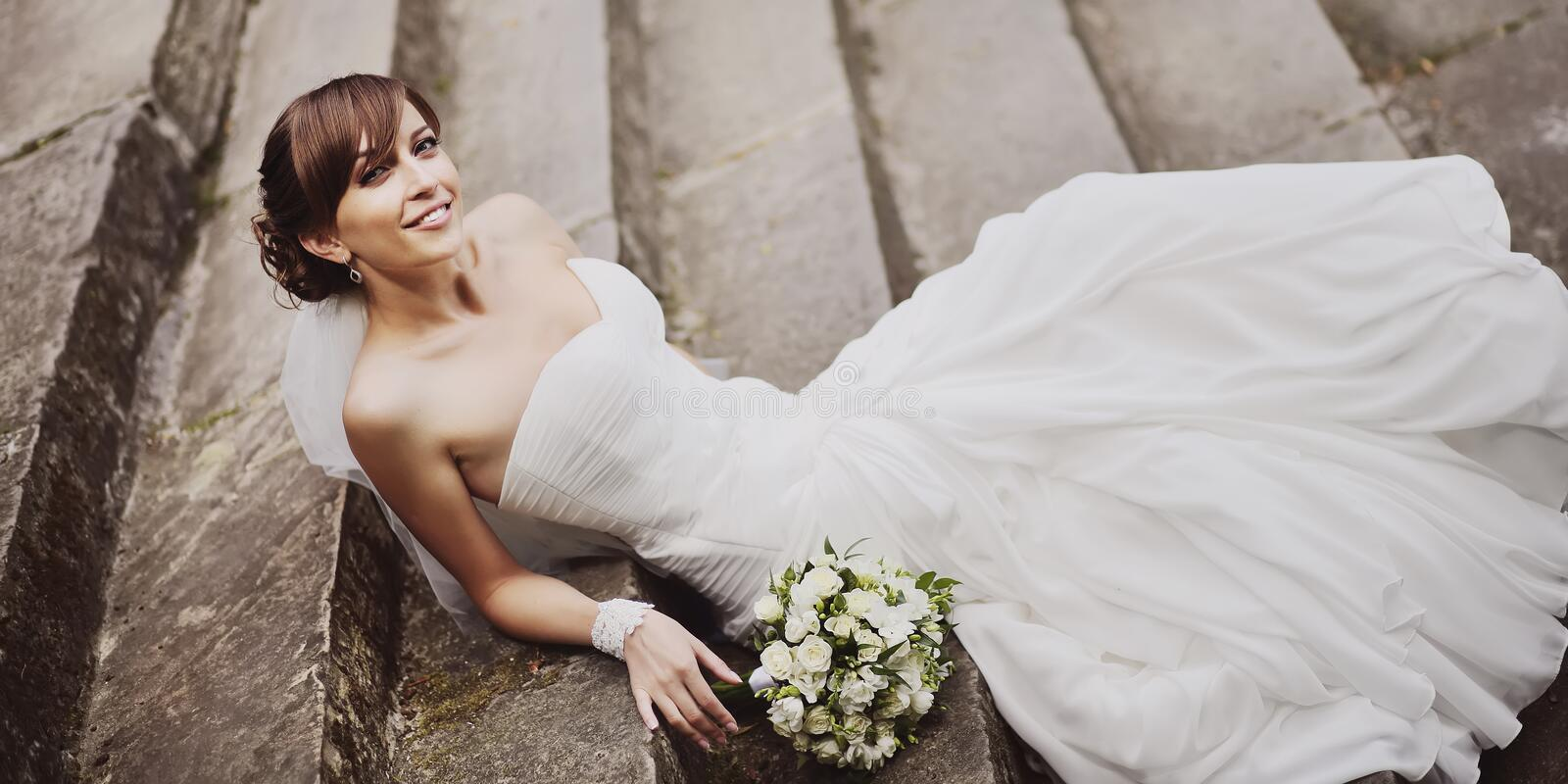 Gorgeous smiling young beautiful bride stock image