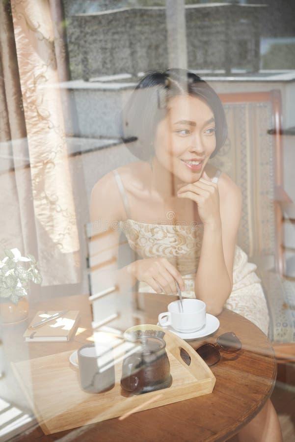 Smiling woman drinking tea stock photo