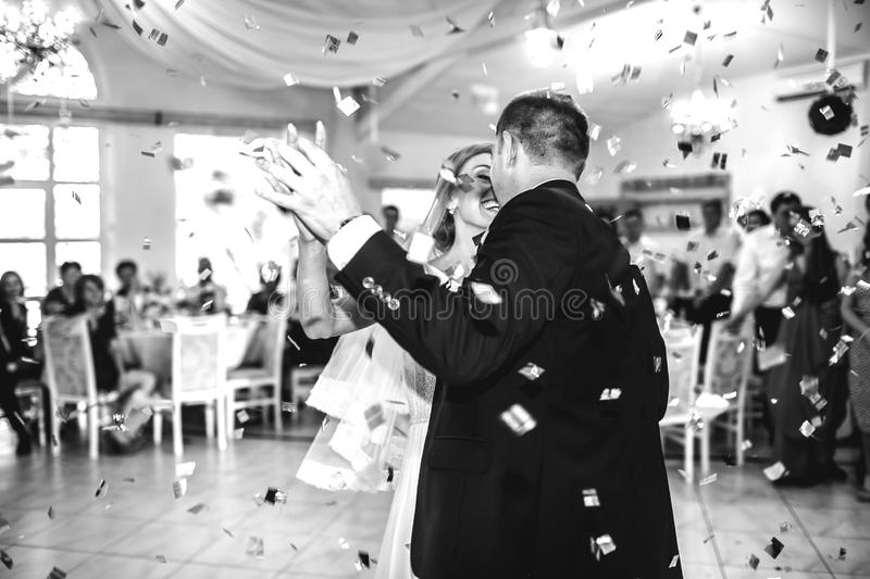 gorgeous stylish happy bride and groom performing their emotional first dance, wedding in a restaurant royalty free stock photography