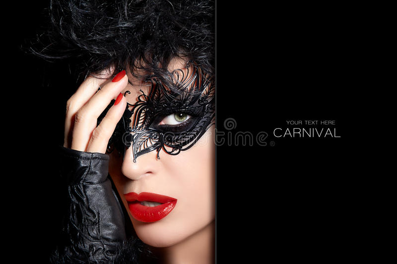 Gorgeous sultry woman wearing a carnival mask stock images