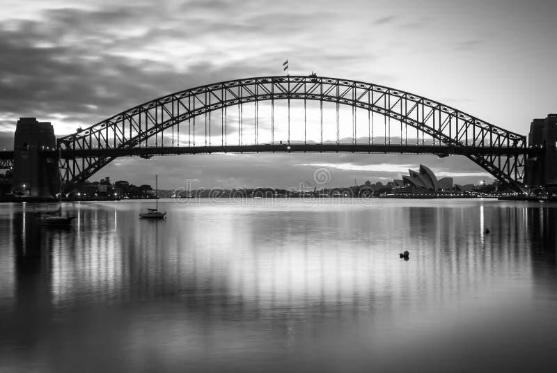 Gorgeous sunset on mighty steel Sydney Harbor bridge crossing the ocean stock photos