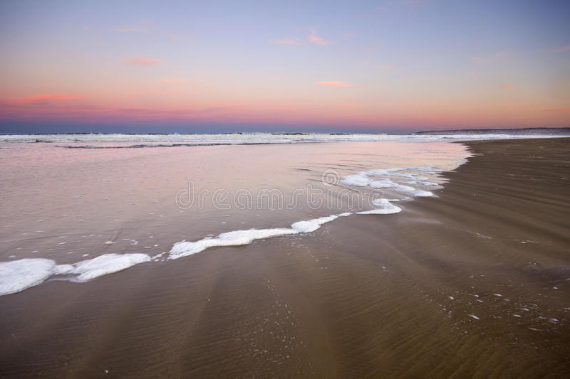 Gorgeous sunset over the ocean and beach royalty free stock photo