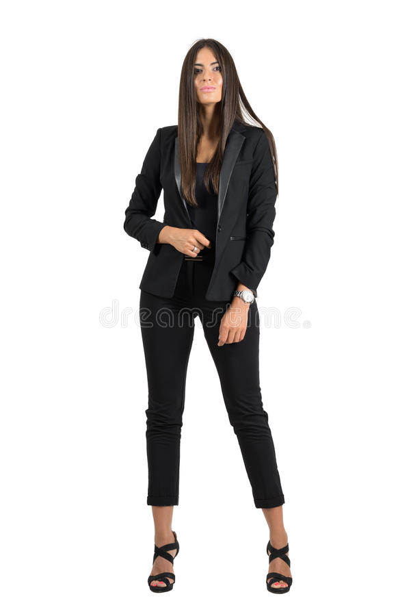 Gorgeous tanned business woman in formal wear confident posing at camera. stock image
