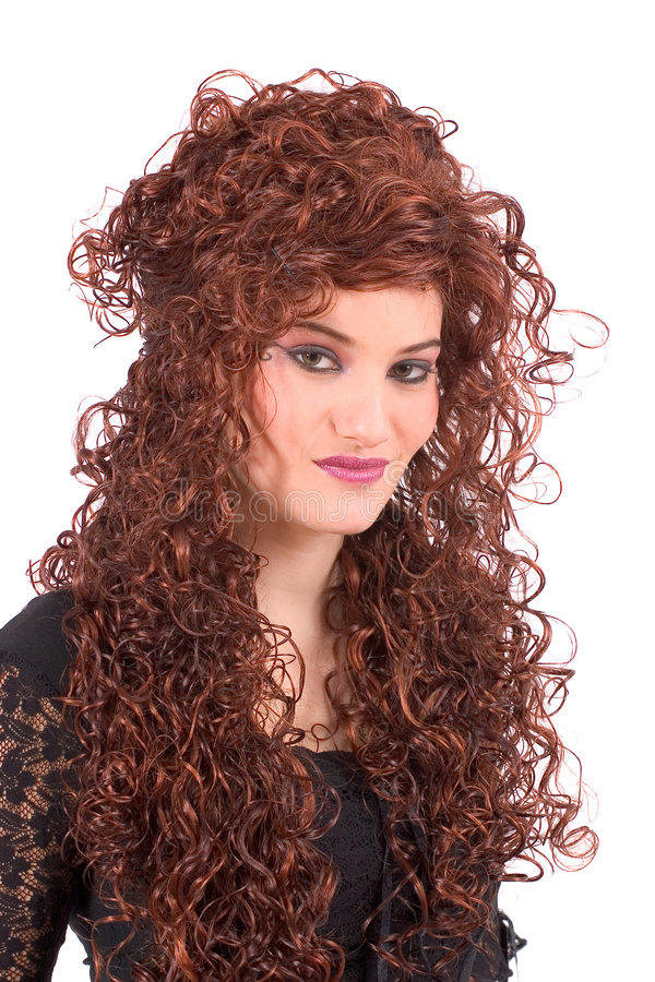 Gorgeous teenager with long curly hair stock image