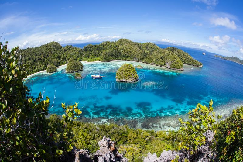 Gorgeous Tropical Lagoon in Raja Ampat. A beautiful lagoon is surrounded by limestone islands in Raja Ampat, Indonesia. This remote, tropical region is known as royalty free stock photo