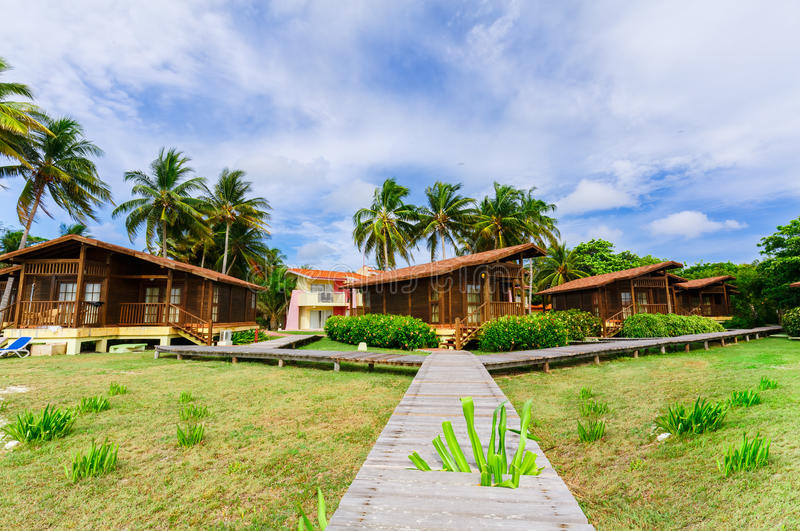 Gorgeous, view of hotel grounds with bungalow cozy, comfortable houses standing near the beach area in tropical garden royalty free stock photo