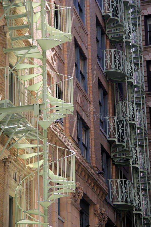 Gorgeous view of spiral staircases on city buildings