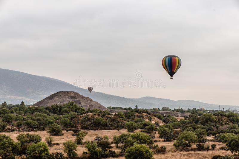 A Gorgeous view of Teotihuacan, The Sun´s Pyramid surrounded by hot air balloons, shot take at the dawn royalty free stock photos