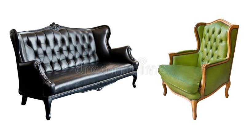 Gorgeous vintage green leather armchair and black leather sofa isolated on white background royalty free stock photos