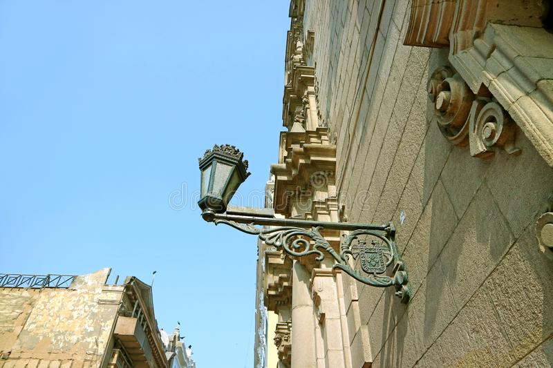 Gorgeous Vintage Style Street Lamp on the Building of the Historic Center of Lima, Capital City of Peru. South America royalty free stock photography