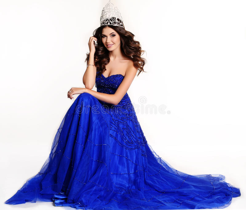 Gorgeous winner of beauty contest wearing luxurious sequin dress and precious crown. Fashion studio photo of gorgeous winner of beauty contest wearing luxurious royalty free stock image