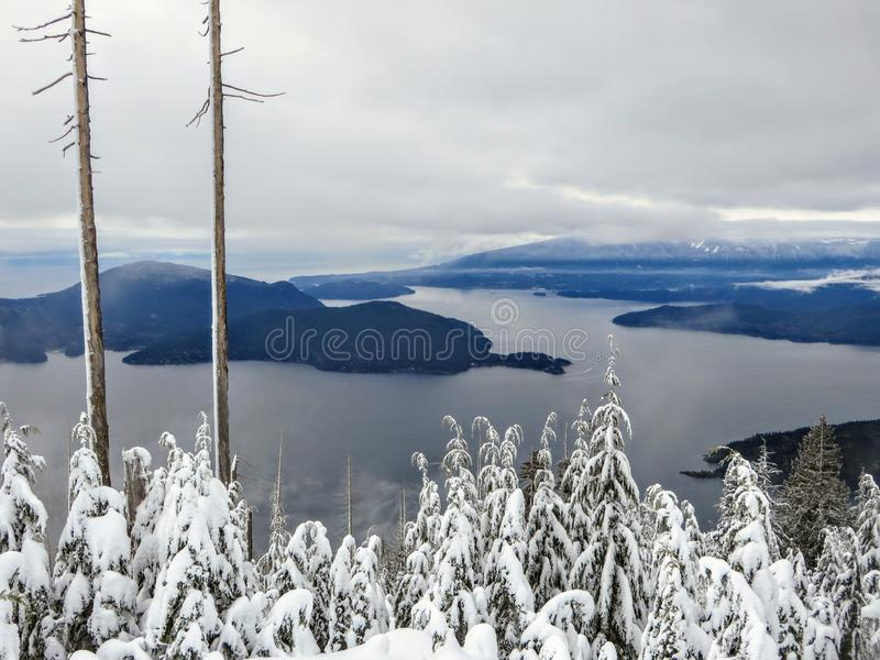 A gorgeous winter landscape on Cypress Mountain overlooking the ocean below royalty free stock photos