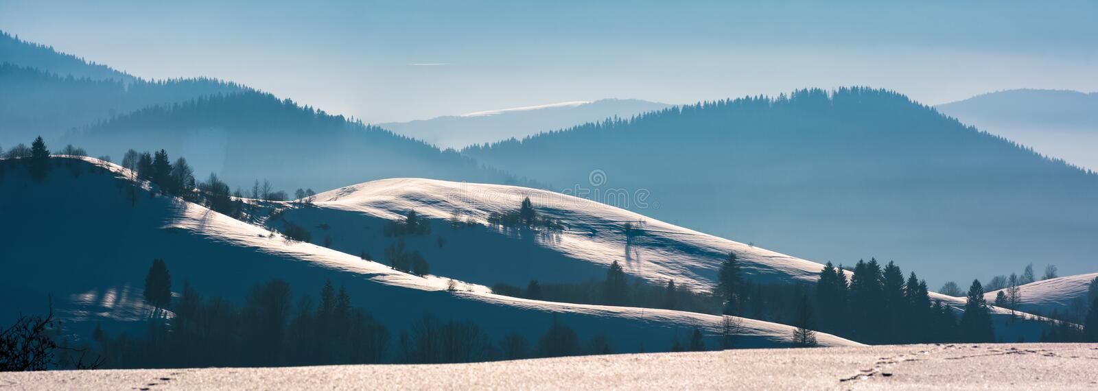 Gorgeous winter panorama of rolling hills stock photography