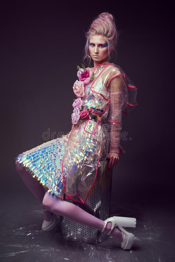 Female in fashion transparent raincoat with splendid make up and hairstyle royalty free stock photos