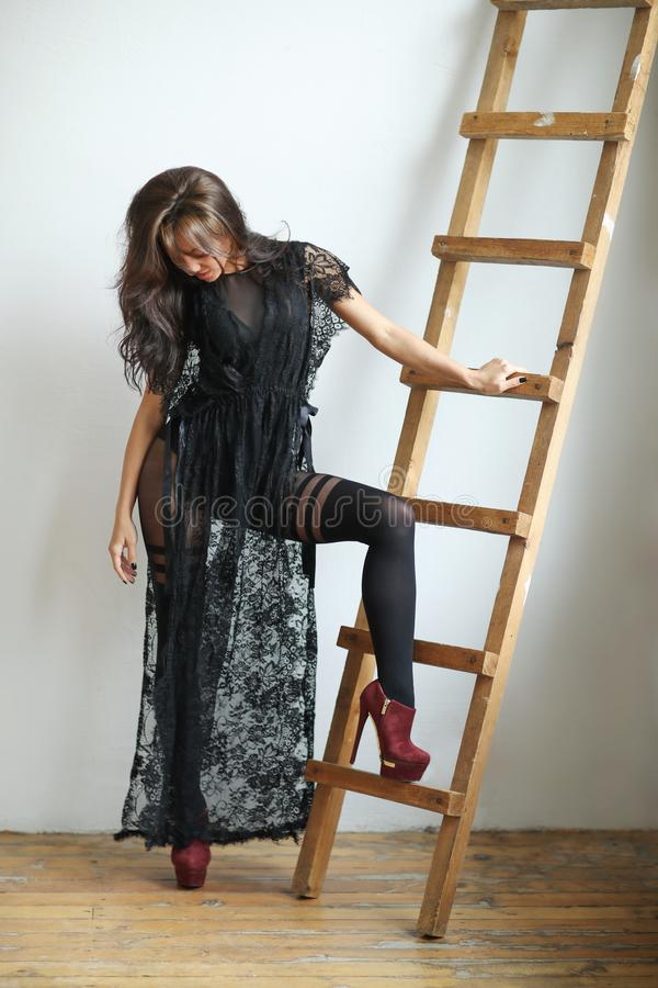 Woman in black dress. Gorgeous woman in black dress stock image