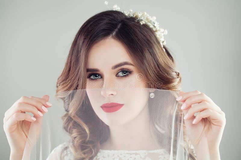 Gorgeous woman bride with makeup and bridal hair stock image