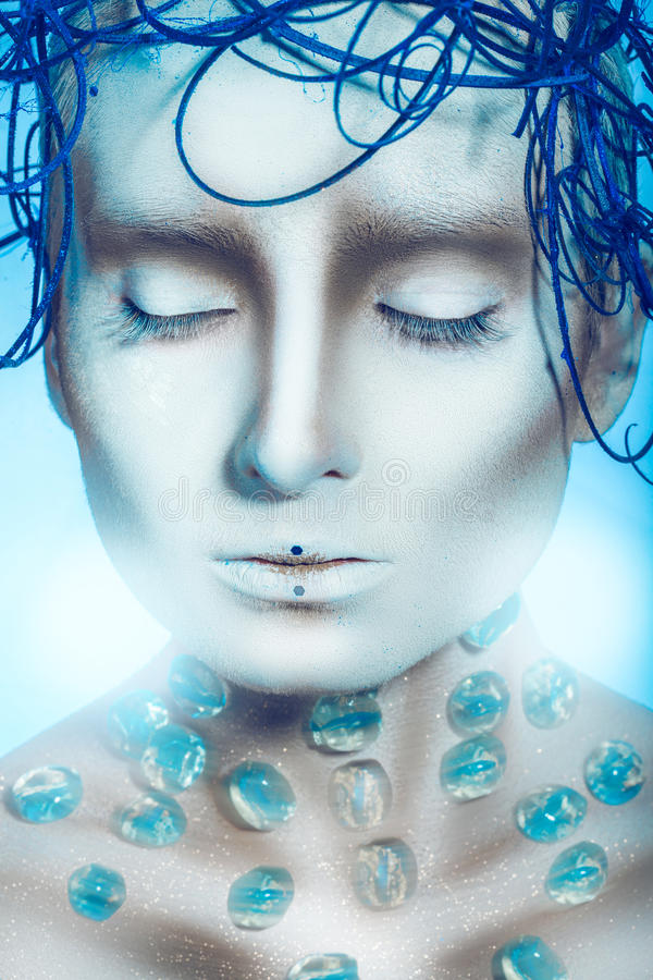 Gorgeous woman with creative hairstyle and body art. In studio royalty free stock photography