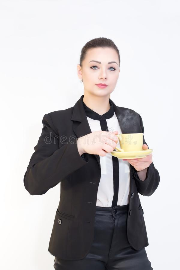 Gorgeous woman with a cup os coffe in hands isolated on white background royalty free stock image