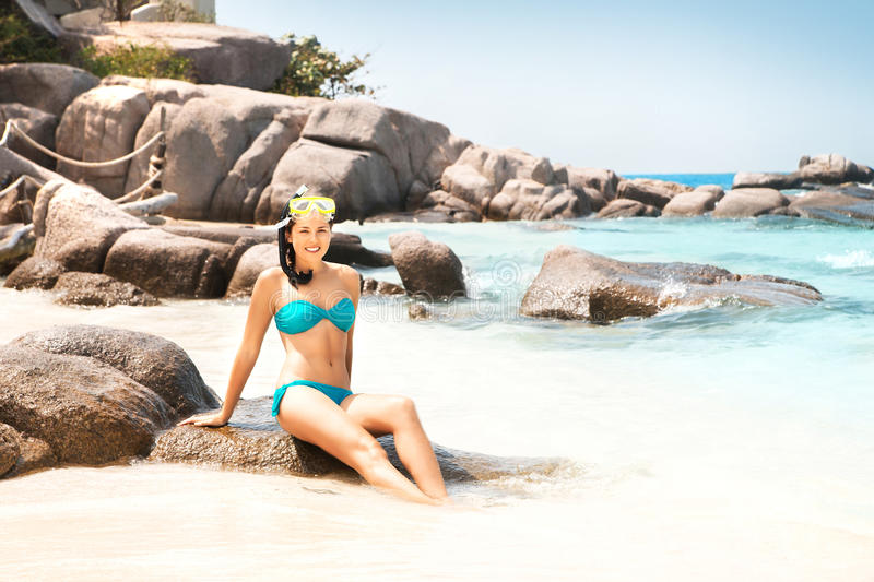 Gorgeous woman in cyan bikini with diving mask stock photography