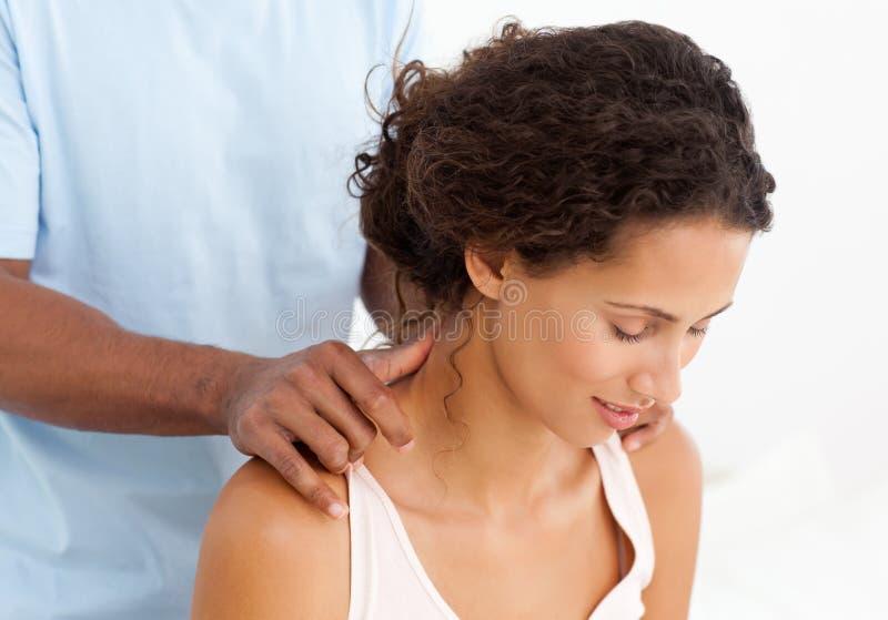 Gorgeous woman enjoying a back massage royalty free stock image