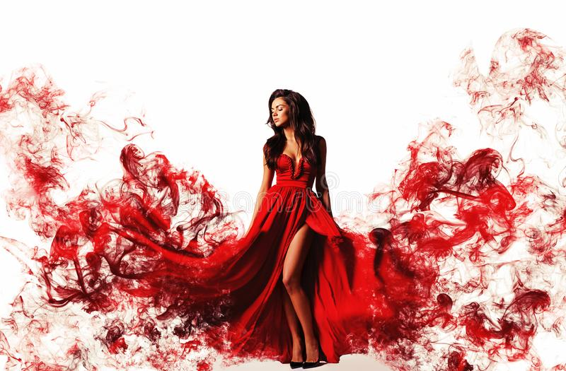 gorgeous woman in a fantasy red dress like a smoke. Studio picture, white background stock image