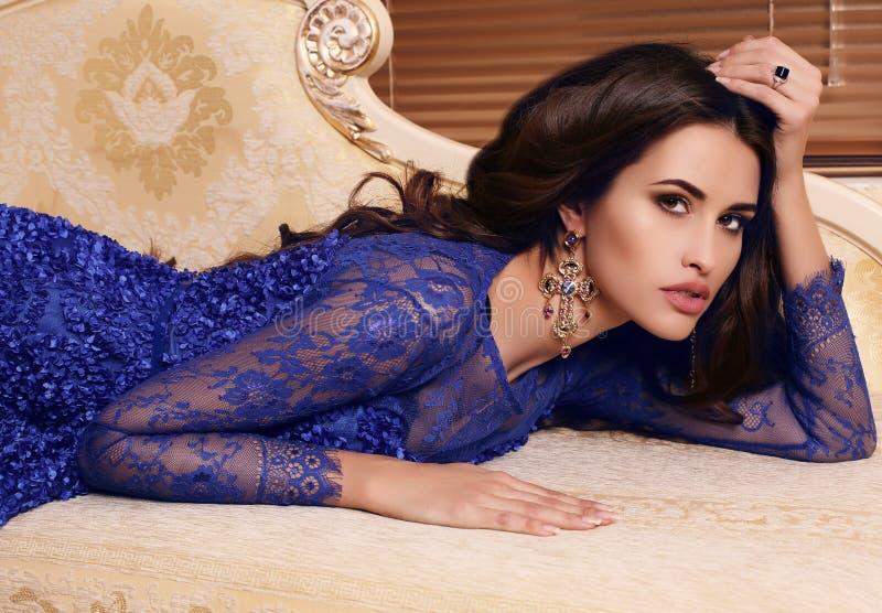 Gorgeous woman with long dark hair in elegant dress with bijou royalty free stock image