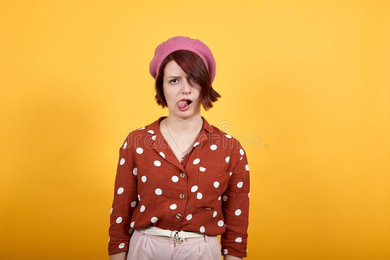 Gorgeous woman looking funny sticking tongue out happy with funny expression stock image