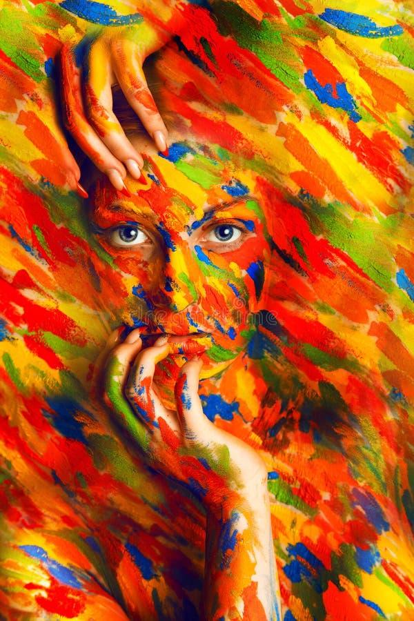 Gorgeous woman in paint strokes stock photos