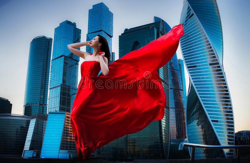 Gorgeous woman in red fluttered dress. Freedom concept. Fashion royalty free stock photo