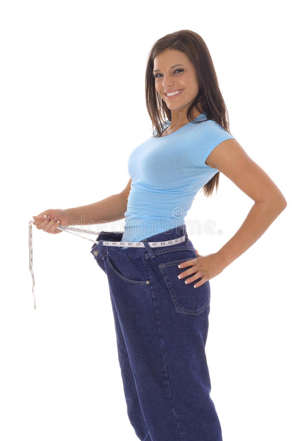 Gorgeous woman showing off her weight loss royalty free stock photos