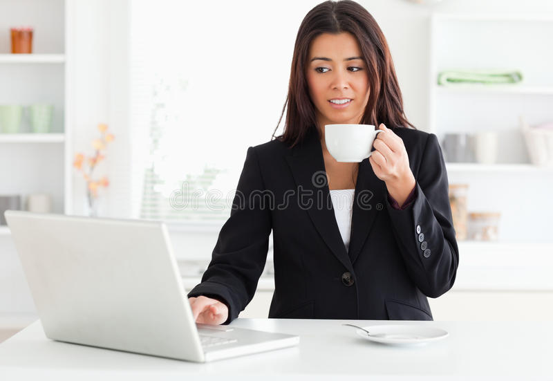 Gorgeous woman in suit enjoying a cup of coffee