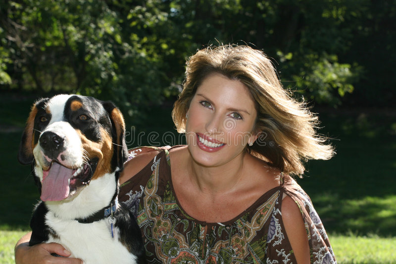 Gorgeous Woman With Swiss Mountain Dog Stock Photography