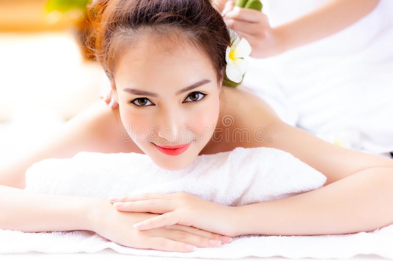 Gorgeous woman is taking a rest from work by using aromatherapy. Or spa shop for massage that makes her feeling relaxed, releasing stress and fatigue from work stock image