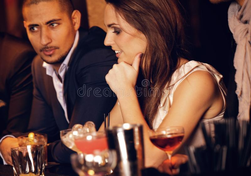 Gorgeous Woman With Boyfriend At The Bar Royalty Free Stock Photography