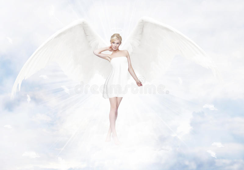 Gorgeous young blond woman as angel in heaven stock photo