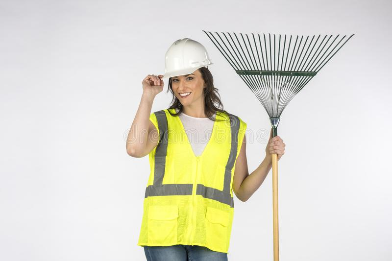 Gorgeous Young Brunette Construction Worker Posing Against A White Background royalty free stock photos