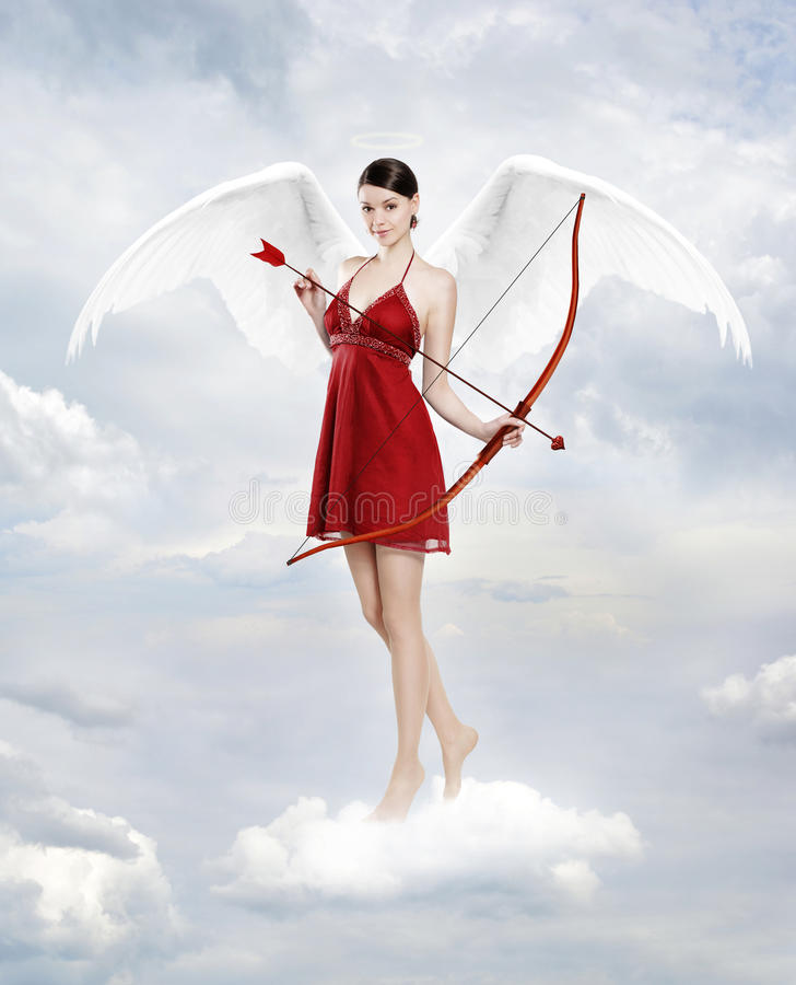 Cupid in clouds stock photos