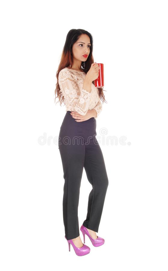 Beautiful businesswoman with red coffee mug royalty free stock photography