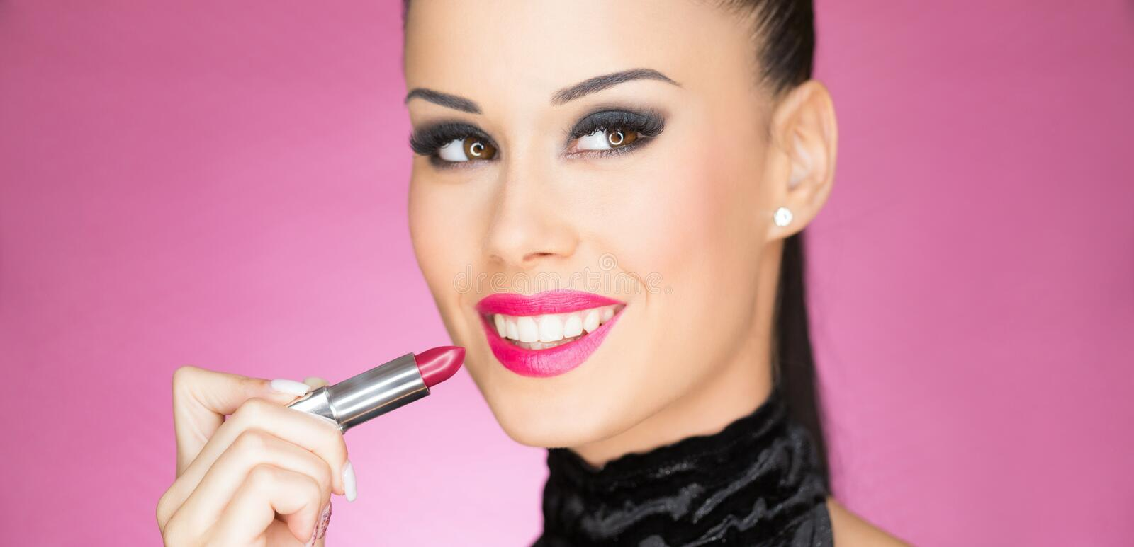 Gorgeous young cosmetics brunette stock photos
