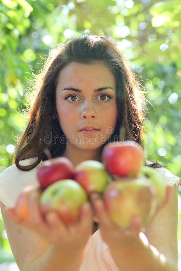Gorgeous young girl with apples