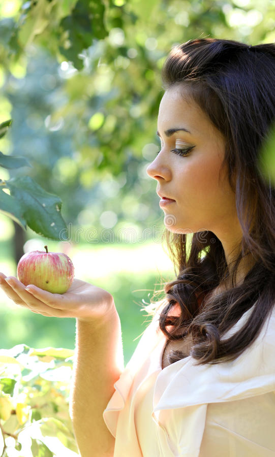Gorgeous young girl with apples stock photo