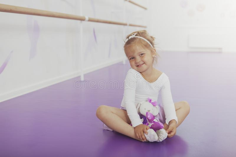 Gorgeous young girl ballerina practicing at dance studio royalty free stock photo