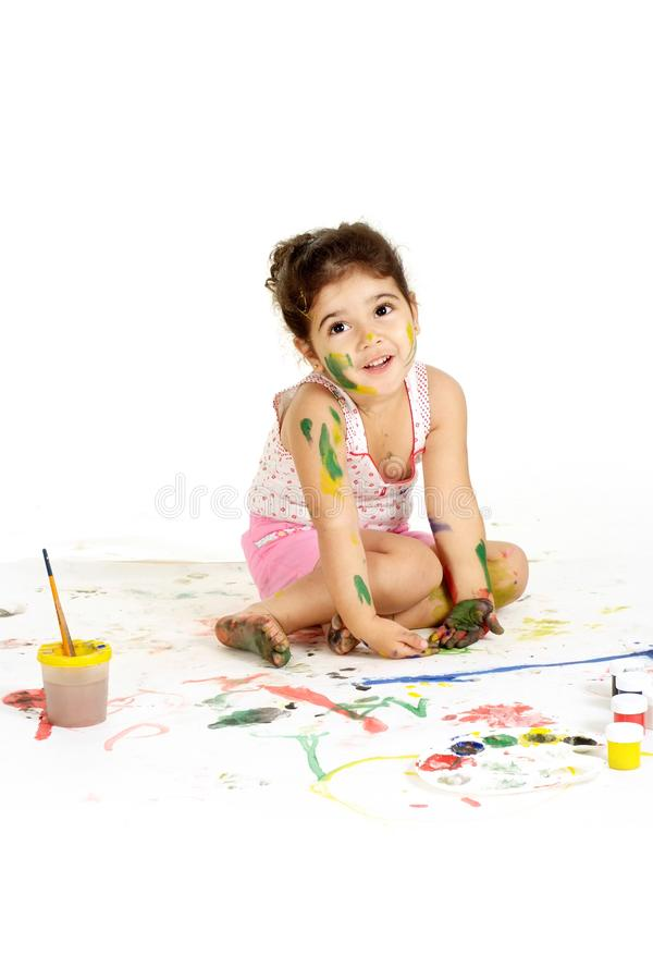 Portrait of gorgeous young girl draws with paints on a white background stock photos