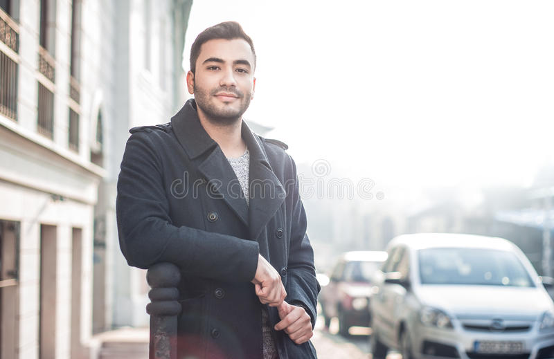 Gorgeous young man. Looking, outdoors.nHandsome beautiful guy posing, outside. Urban scene. Copyspace royalty free stock photos