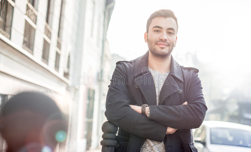 Gorgeous young man. Gorgeous turk young man looking, outdoors. Handsome guy stock photo